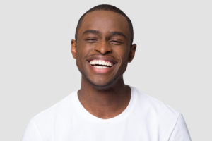 Man with beautiful smile thanks to veneers